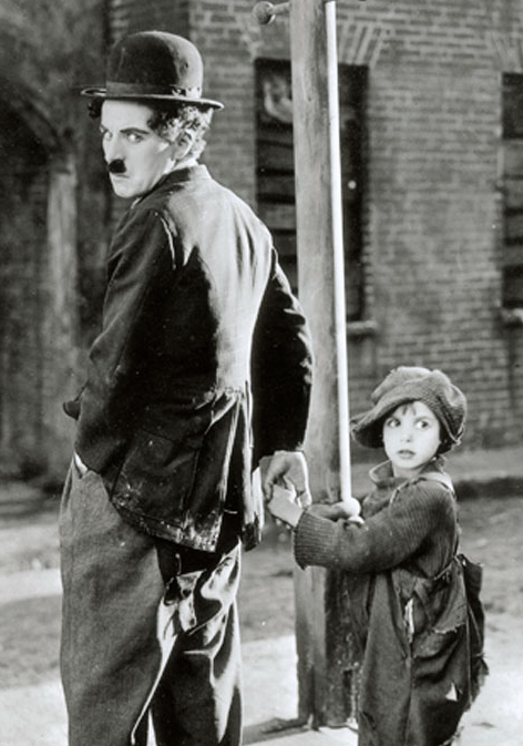 Charlie Chaplin and The Kid by a lamp post