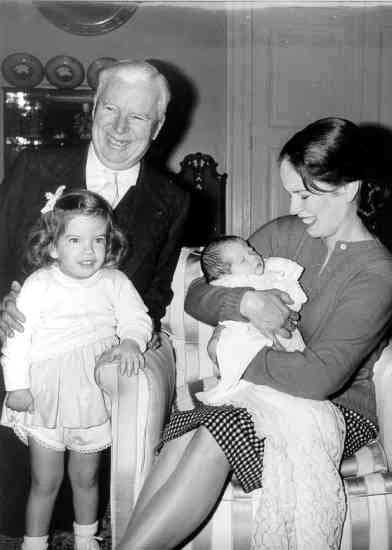 Charlie Chaplin with Oona and some of their children
